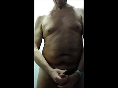 Wank in a swimming pool changing cubicle