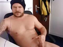Handsome tatooed muscular guy wanking