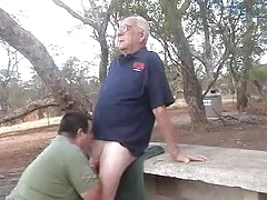 Younger men sucking a older men's cock