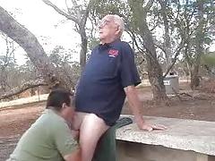 Younger men sucking a older men's cock