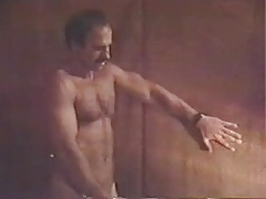 Moustached handsome daddy in gay(ish) scene