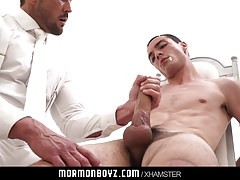 Handsome priest leader strokes bound gay missionarys cock